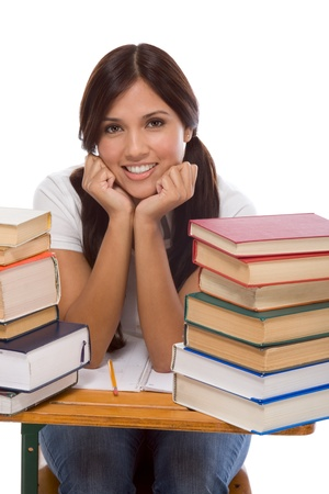 education series - Friendly ethnic Latina female high school student with books by desk photo