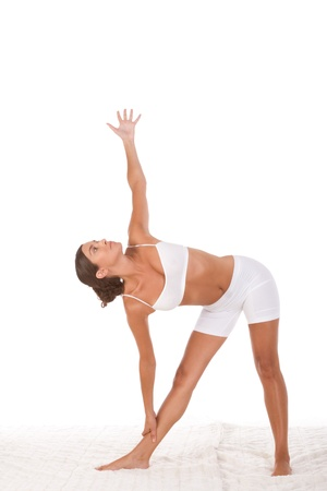 yoga pose Triangle - female in sport clothes performing exercise Stock Photo