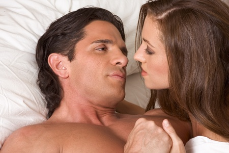 young heterosexual couple in bed photo