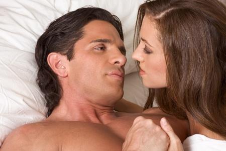 young heterosexual couple in bed photo