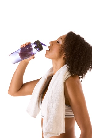 Dark skinned female in sporty outfit holding bottle of water