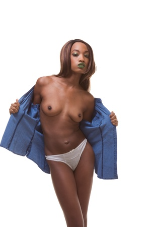 Young female beauty ethnic fashion model of African-American ethnicity wearing just jeans jacket, thongs and high heels only and otherwise nude, undressing photo