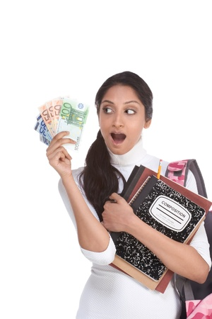 Ethnic Indian college student with compositions notebook, copybooks and backpack holds pile euro bills