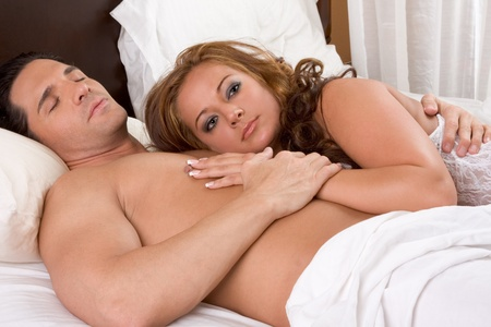 Young heterosexual couple love in bed Stock Photo - 10425813
