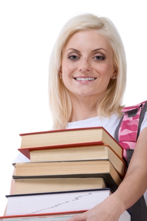 late 20s: Young blond Caucasian female college student holding huge pile of educational books from library