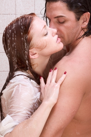 foreplay sex: Loving affectionate young heterosexual couple in affectionate sensual kiss after taking shower. Mid adult Caucasian men in late 30s and young Caucasian redhead woman in early 20s Stock Photo