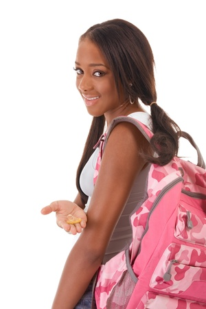 sex education: Sex education Friendly ethnic black woman high school student with backpack and condom