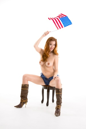 Topless Caucasian woman holding American flag Stock Photo - 10690903