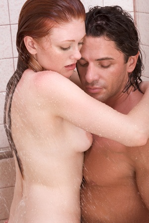 Loving affectionate nude young heterosexual couple in affectionate sensual kiss after taking shower. Mid adult Caucasian men in late 30s and young Caucasian redhead woman in early 20s Stock Photo - 10778423