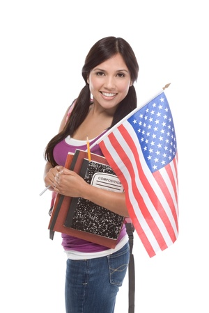 Friendly ethnic Latina woman high school student standing holding American flag Stock Photo - 10778417