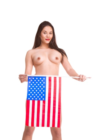 Topless young Asian woman standing holding American flag in front of her photo