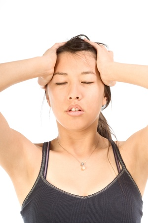 woman headache: Young female squeezing her head apparently having headache