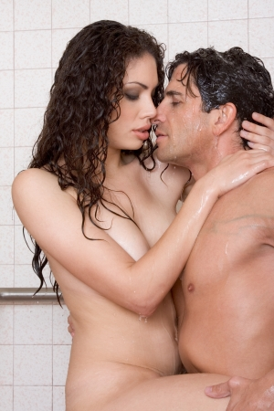 Loving affectionate nude young heterosexual couple in affectionate sensual kiss after taking shower. Mid adult Caucasian men in late 30s and young Latina woman in early 20s Stock Photo - 11040564