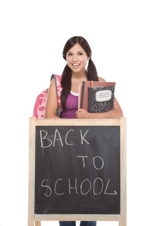 high school series: education series template - Friendly ethnic Latina woman high school student by chalkboard Stock Photo