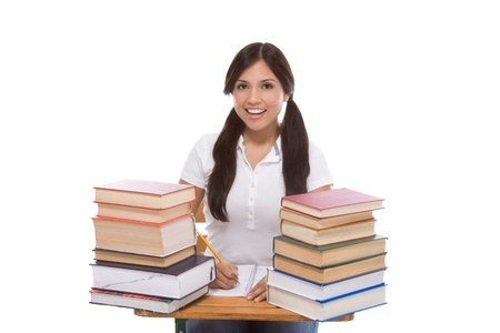 high school series: education series - Friendly ethnic Latina female high school student with books by desk Stock Photo