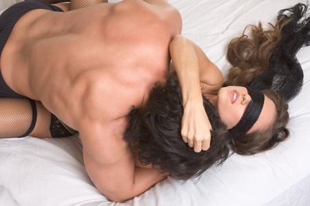 adult sex: Loving affectionate heterosexual couple in affectionate sensual kiss. Woman eyes are covered by black scarf