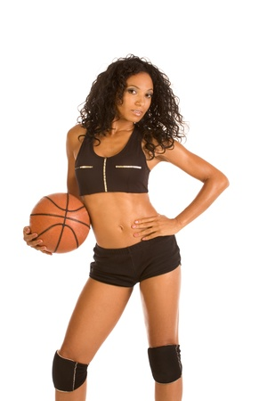 Fitness series - sexy mid aged woman couch in sport clothes holding basketball ball Stock Photo - 11688679