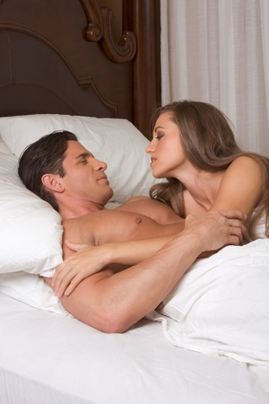young heterosexual couple in bed Stock Photo - 11688691