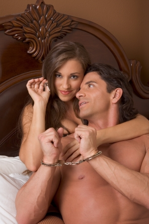 Sexy Caucasian couple in love sexual games, man in handcuffs photo