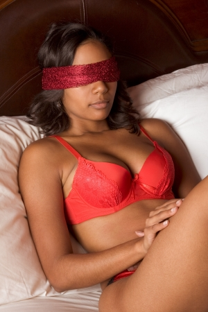 afro american nude: Ethnic black multiethnic woman of Indian and African mix blindfold with scarf covering eyes