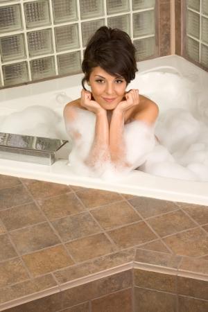 bathtub Sensual sexy female relaxing in hot tub bath with foam photo