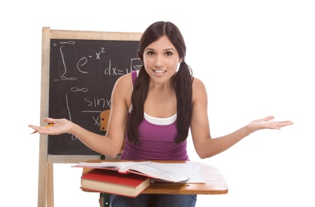 Stressed High school or college Latina female student sitting by the desk at math class. Blackboard with complicated advanced mathematical formals is visible in background Stock Photo - 11930736