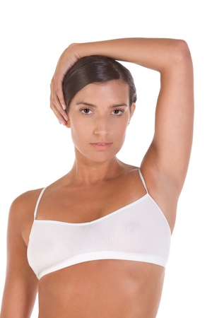 Young Caucasian woman in white sports bra
