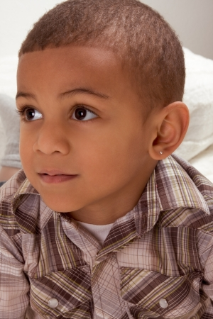 pierced: Portrait of ethnic Young little boy in checkered shirt