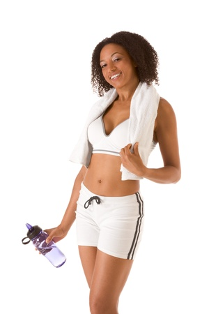 spandex: Ethnic female in sporty outfit holding bottle of water (Squinting) Stock Photo