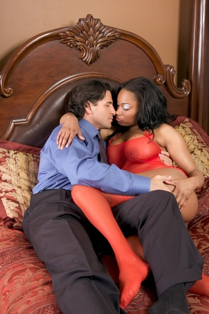 adult sex: Interracial Lovers - sensual heterosexual couple making love. African-American black woman and Caucasian man Stock Photo