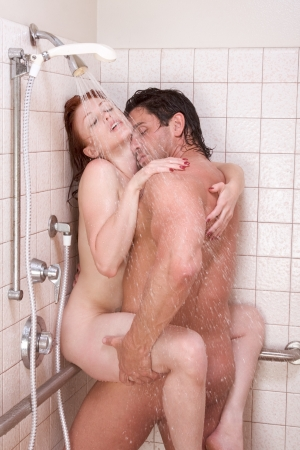 sex couple: Loving affectionate nude young heterosexual couple in affectionate sensual kiss after taking shower. Mid adult Caucasian men in late 30s and young Caucasian redhead woman in early 20s