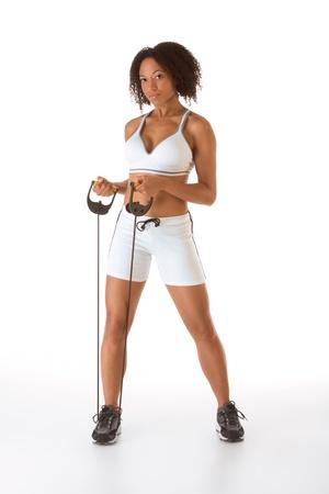 hair band: Dark skinned female stretching using rubber band Stock Photo