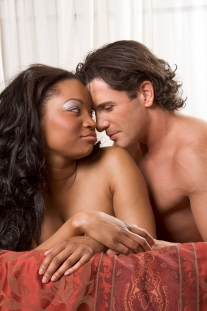 nude black women: Interracial Lovers - sensual heterosexual couple making love. African-American black woman and Caucasian man Stock Photo