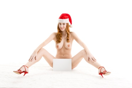 Sensual sexy nude Caucasian woman Santa Claus in Christmas hat with blank paper copyspace