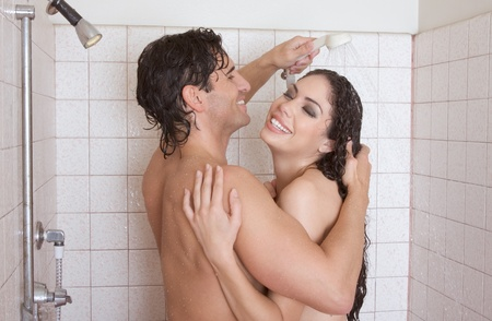 Loving affectionate nude young heterosexual couple in affectionate sensual kiss after taking shower. Mid adult Caucasian men in late 30s and young Latina woman in early 20s Stock Photo - 12102374