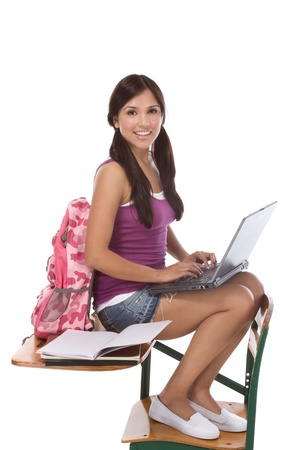 denim skirt: education series template - Friendly young woman high school student typing on portable computer