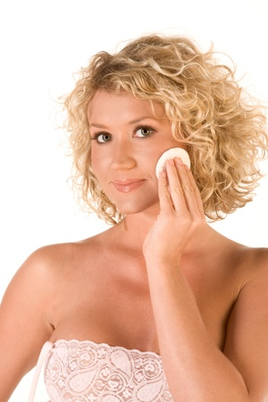 cotton pad: Beautiful blonde removing facial make-up