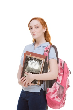 copybook: Friendly Caucasian High school girl student standing with backpack and holding books, notebooks and composition book