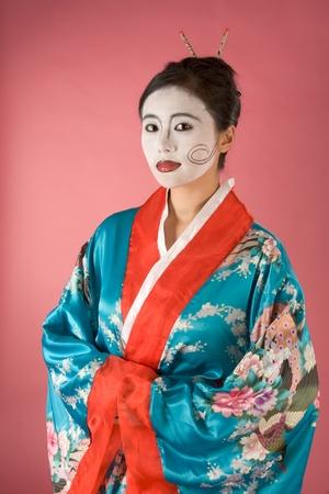 Asian female with geisha style face paint in yukata  kimono