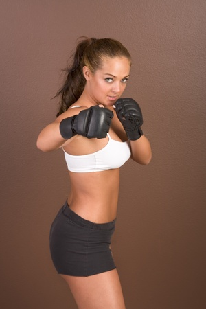 martial art: Woman in boxing gloves Stock Photo
