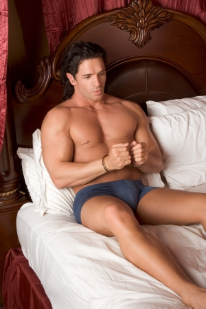 mystery handcuffed man in bed Stock Photo