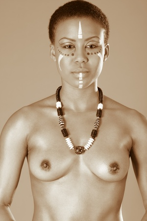 Portrait of topless African American woman wearing original tribal themed face-paint and necklace Stock Photo - 12780935