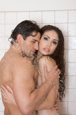 Loving affectionate nude young heterosexual couple in affectionate sensual kiss after taking shower. Mid adult Caucasian men in late 30s and young Latina woman in early 20s Stock Photo - 12780938