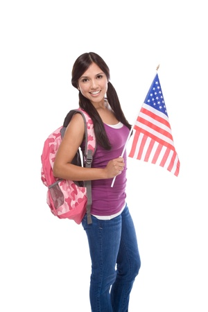 Friendly ethnic Latina woman high school student standing holding American flag Banque d'images