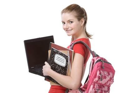 estudiante de secundaria: amigable cauc�sica escuela secundaria colegiala estudiante con mochila, la celebraci�n de ordenador port�til, ordenadores port�tiles y el libro de la composici�n Foto de archivo