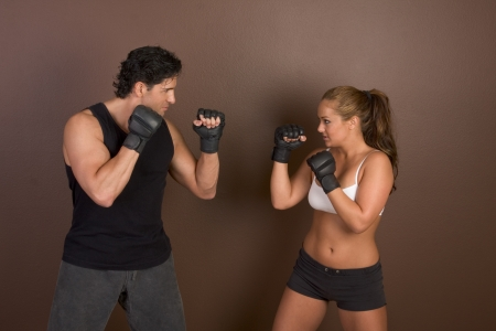 Woman and coach are boxing photo