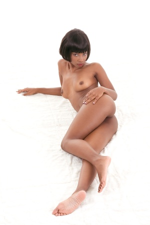 Sensual nude topless black ethnic African-American woman lying on blanket Stock Photo