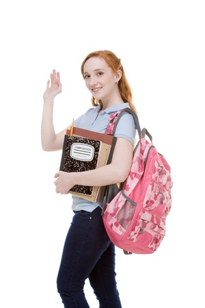 high school series: education series - Friendly Caucasian female high school student with backpack and composition book greeting you