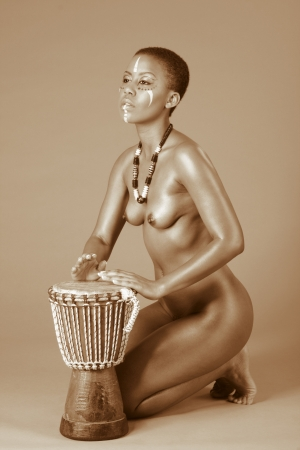 afro american nude: Portrait of topless naked African American woman wearing original tribal themed face-paint and necklace