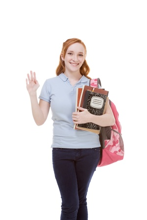 education series - Friendly Caucasian female high school student with backpack and composition book greeting you